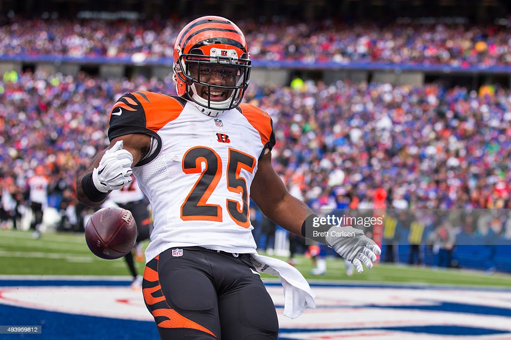 Giovani Bernard of the Cincinnati Bengals celebrates a touchdown run against the Buffalo Bills on October 18 2015 at Ralph Wilson Stadium in Orchard...