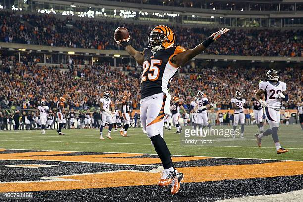 Giovani Bernard of the Cincinnati Bengals celebrates after scoring a touchdown during the third quarter of the game against the Denver Broncos at...