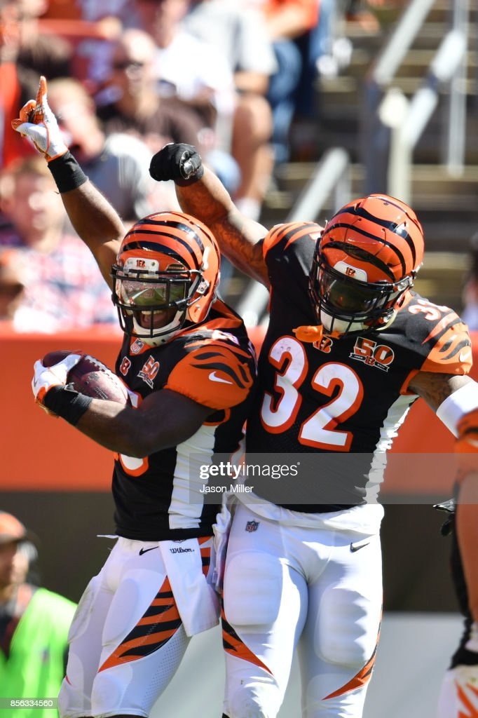 Giovani Bernard #25 of the Cincinnati Bengals celebrates his touch down with Jeremy Hill #32 of the Cincinnati Bengals against the Cleveland Browns at FirstEnergy Stadium on October 1, 2017 in Cleveland, Ohio.