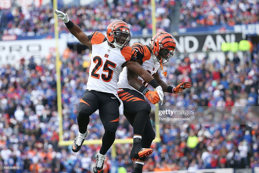 <a gi-track='captionPersonalityLinkClicked' href=/galleries/search?phrase=Giovani+Bernard&family=editorial&specificpeople=8162745 ng-click='$event.stopPropagation()'>Giovani Bernard</a> #25 of the Cincinnati Bengals celebrates his touchdown against the Buffalo Bills with <a gi-track='captionPersonalityLinkClicked' href=/galleries/search?phrase=Jeremy+Hill+-+American+Football+Player&family=editorial&specificpeople=11392891 ng-click='$event.stopPropagation()'>Jeremy Hill</a> #32 of the Cincinnati Bengals during the first half at Ralph Wilson Stadium on October 18, 2015 in Orchard Park, New York.
