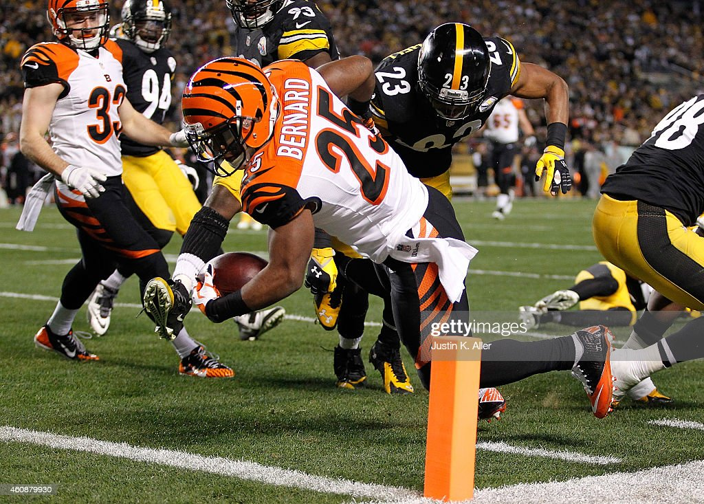 Giovani Bernard of the Cincinnati Bengals dives in front of Mike Mitchell of the Pittsburgh Steelers for a touchdown during the first quarter at...