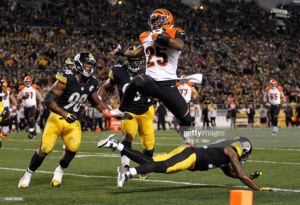 <a gi-track='captionPersonalityLinkClicked' href=/galleries/search?phrase=Giovani+Bernard&family=editorial&specificpeople=8162745 ng-click='$event.stopPropagation()'>Giovani Bernard</a> #25 of the Cincinnati Bengals hurdles over <a gi-track='captionPersonalityLinkClicked' href=/galleries/search?phrase=William+Gay&family=editorial&specificpeople=2108843 ng-click='$event.stopPropagation()'>William Gay</a> #22 of the Pittsburgh Steelers and scores a touchdown during the first quarter at Heinz Field on December 28, 2014 in Pittsburgh, Pennsylvania.