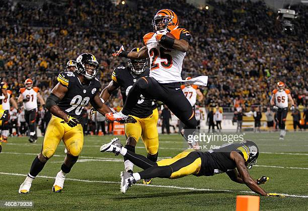 Giovani Bernard of the Cincinnati Bengals hurdles over William Gay of the Pittsburgh Steelers and scores a touchdown during the first quarter at...