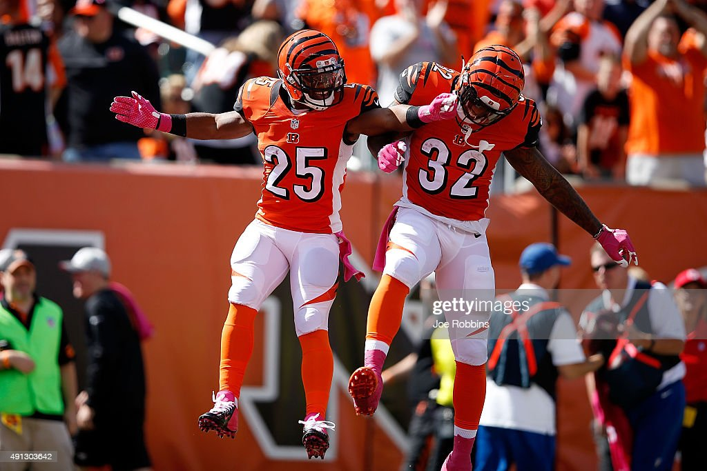 Giovani Bernard #25 of the Cincinnati Bengals is congratulated by Jeremy Hill #32 of the Cincinnati Bengals after scoring a touchdown during the first quarter of the game against the Kansas City Chiefs at Paul Brown Stadium on October 4, 2015 in Cincinnati, Ohio.