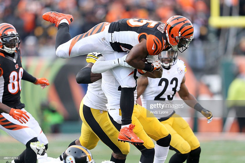 Giovani Bernard of the Cincinnati Bengals is tackled by Brice McCain of the Pittsburgh Steelers during the fourth quarter at Paul Brown Stadium on...