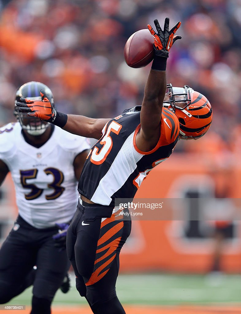 <a gi-track='captionPersonalityLinkClicked' href=/galleries/search?phrase=Giovani+Bernard&family=editorial&specificpeople=8162745 ng-click='$event.stopPropagation()'>Giovani Bernard</a> #25 of the Cincinnati Bengals reaches to catch a pass during the NFL game against the Baltimore Ravens at Paul Brown Stadium on December 29, 2013 in Cincinnati, Ohio.