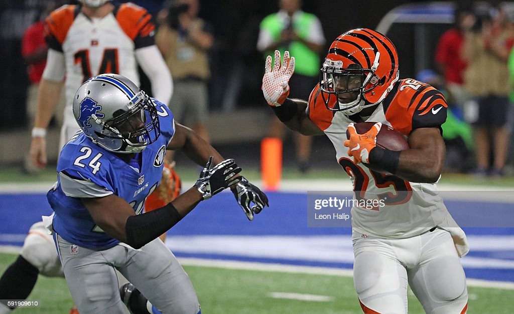 Giovani Bernard of the Cincinnati Bengals runs for a short gain as Nevin Lawson of the Detroit Lions attempts to make the stop during the second...