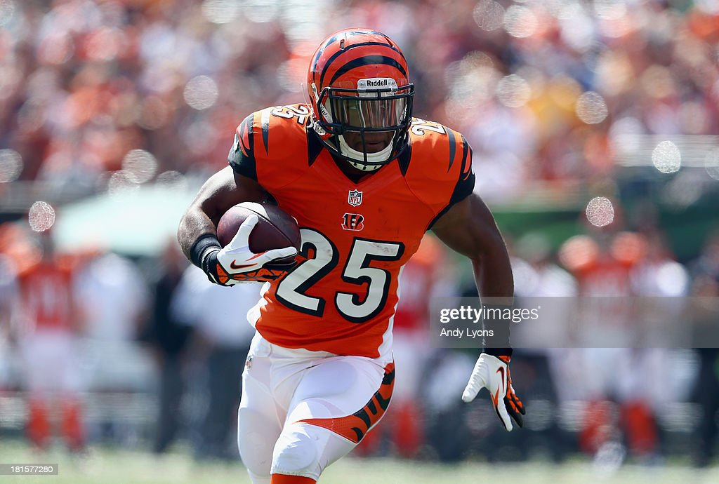 Giovani Bernard of the Cincinnati Bengals runs for a touchdown during the NFL game against the Green Bay Packers at Paul Brown Stadium on September...