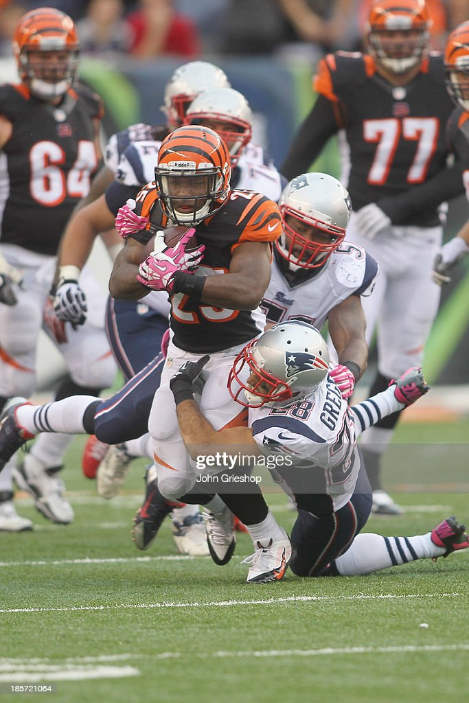 Giovani Bernard #25 of the Cincinnati Bengals runs the ball upfield during the game against the New England Patriots at Paul Brown Stadium on October 6, 2013 in Cincinnati, Ohio.