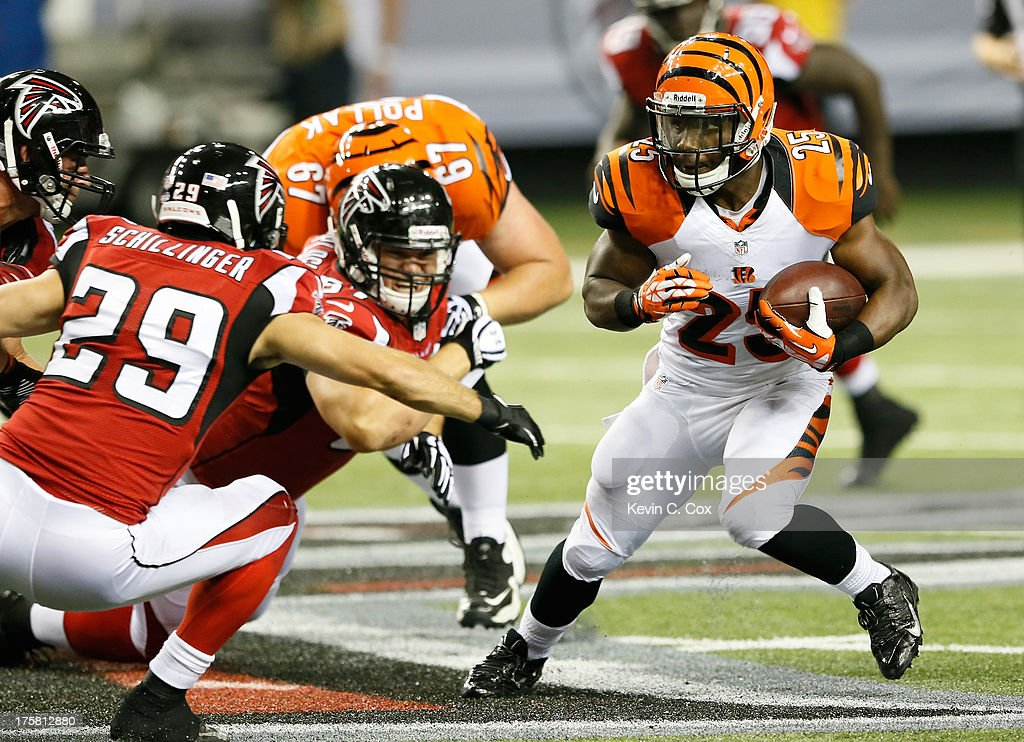 <a gi-track='captionPersonalityLinkClicked' href=/galleries/search?phrase=Giovani+Bernard&family=editorial&specificpeople=8162745 ng-click='$event.stopPropagation()'>Giovani Bernard</a> #25 of the Cincinnati Bengals rushes away from Shann Schillinger #29 of the Atlanta Falcons at Georgia Dome on August 8, 2013 in Atlanta, Georgia.