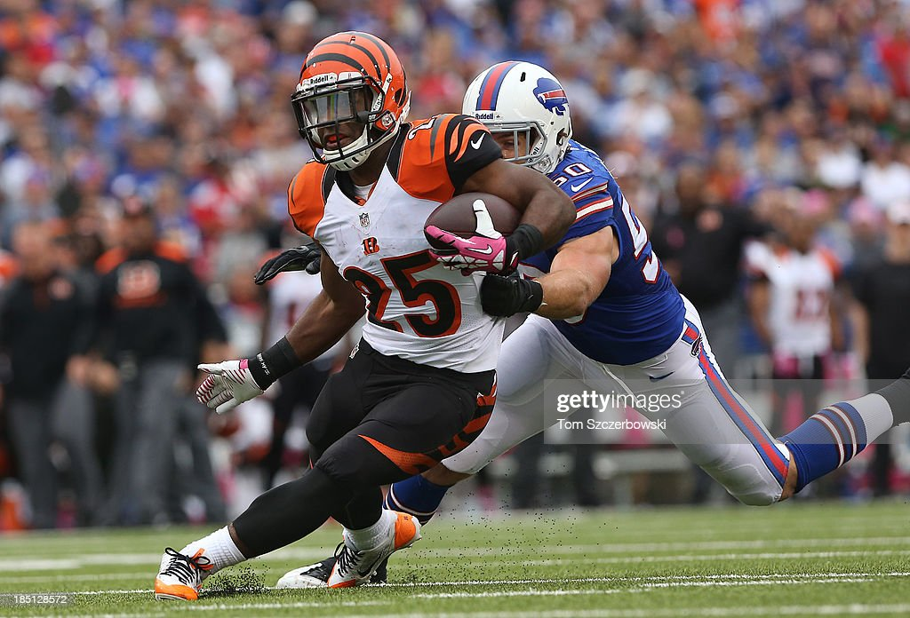 Giovani Bernard of the Cincinnati Bengals rushes in for a touchdown during NFL game action as he gets away from Kiko Alonso of the Buffalo Bills at...