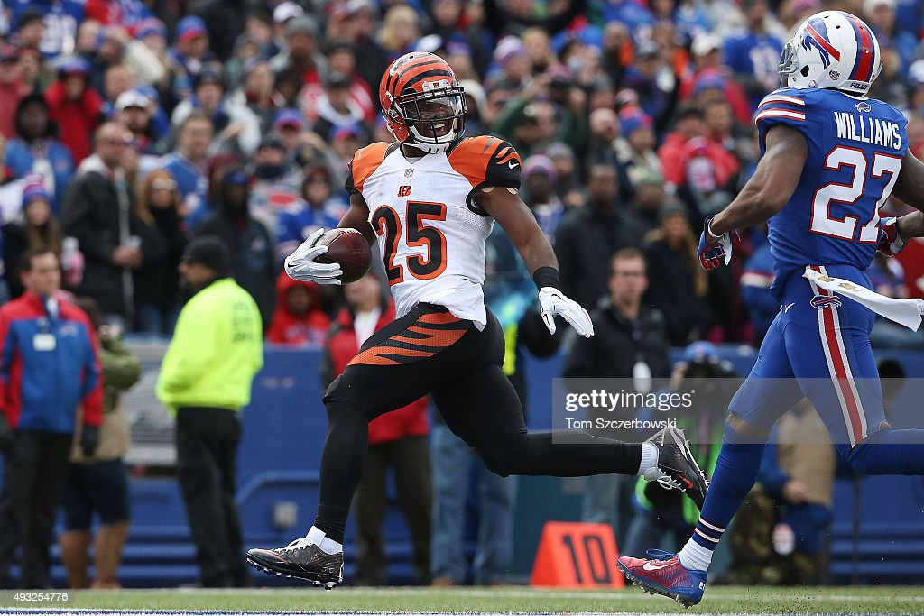 Giovani Bernard of the Cincinnati Bengals scores a touchdown past Duke Williams of the Buffalo Bills during the first half at Ralph Wilson Stadium on...