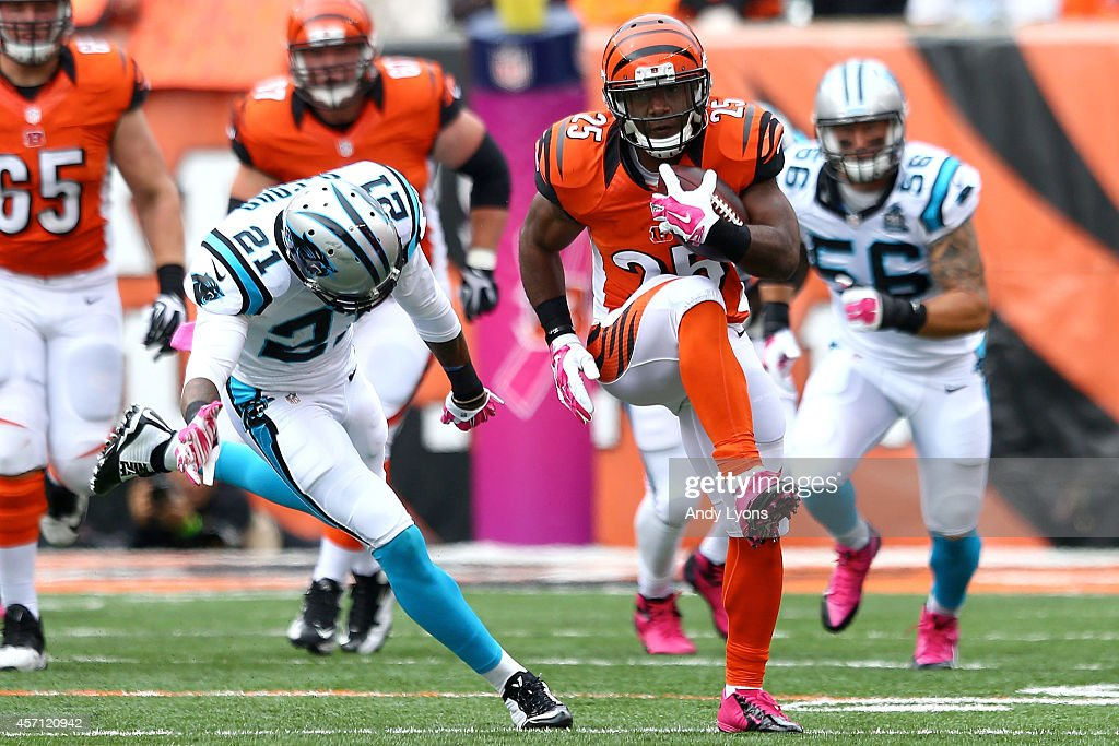 <a gi-track='captionPersonalityLinkClicked' href=/galleries/search?phrase=Giovani+Bernard&family=editorial&specificpeople=8162745 ng-click='$event.stopPropagation()'>Giovani Bernard</a> #25 of the Cincinnati Bengals slips past <a gi-track='captionPersonalityLinkClicked' href=/galleries/search?phrase=Thomas+DeCoud&family=editorial&specificpeople=4037323 ng-click='$event.stopPropagation()'>Thomas DeCoud</a> #21 of the Carolina Panthers to score on an 89 yard touchdown run during the second quarter at Paul Brown Stadium on October 12, 2014 in Cincinnati, Ohio.