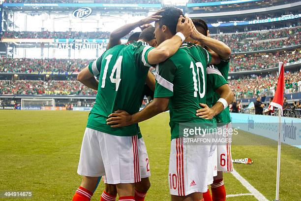 Giovani dos Santos celebrates with his team mates after scoring the third goal of the match during the International Friendly match between Mexico...