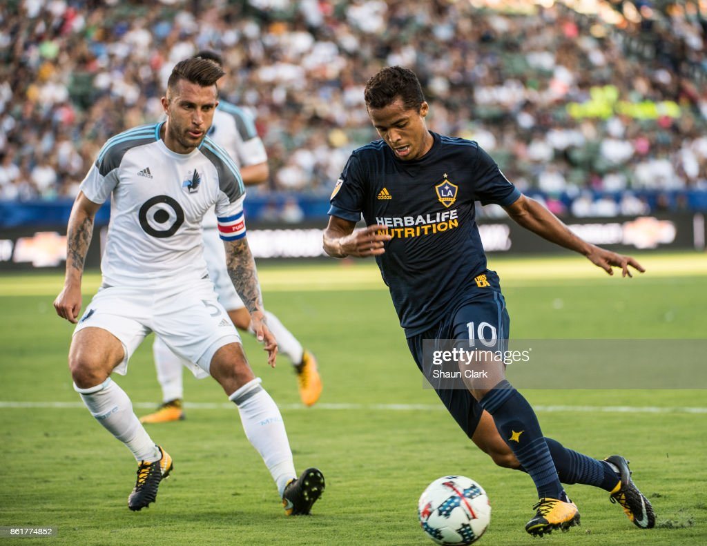 Giovani dos Santos #10 of Los Angeles Galaxy races toward goal as Francisco Calvo #5 of Minnesota United defends during the Los Angeles Galaxy's MLS match against Minnesota United at the StubHub Center on October 15, 2017 in Carson, California. Los Angeles Galaxy won the match 3-0