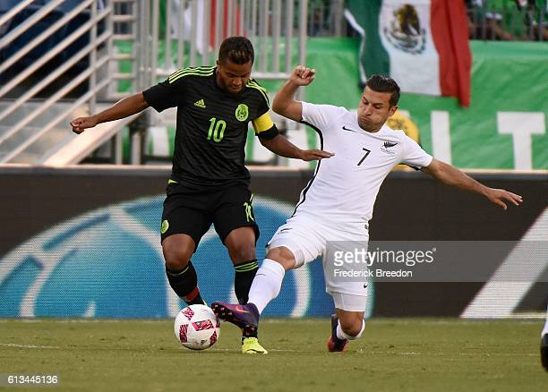 Giovani Dos Santos of Mexico and Kosta Barbarouses of New Zealand fight for a loose ball during the first half at Nissan Stadium on October 8 2016 in...