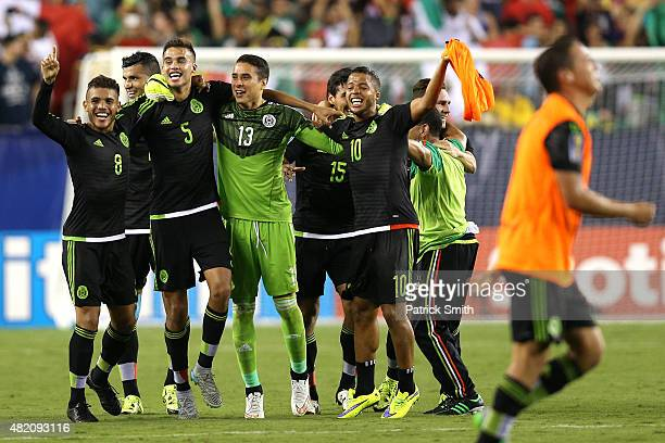 Giovani Dos Santos of Mexico and teammates celebrate after defeating Jamaica in the CONCACAF Gold Cup Final at Lincoln Financial Field on July 26...