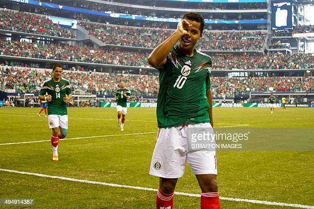 Giovani dos Santos of Mexico celebrates a scored goal the third of the match during the International Friendly match between Mexico and Ecuador at...