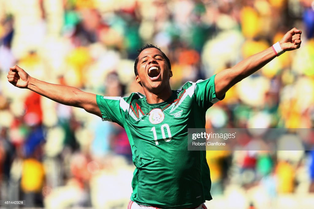 Giovani dos Santos of Mexico celebrates scoring his team's first goal during the 2014 FIFA World Cup Brazil Round of 16 match between Netherlands and Mexico at Castelao on June 29, 2014 in Fortaleza, Brazil.