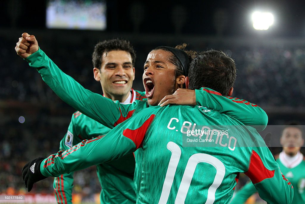 Giovani Dos Santos of Mexico celebrates with Cuauhtemoc Blanco after he scored a penalty for his team's second goal during the 2010 FIFA World Cup South Africa Group A match between France and Mexico at the Peter Mokaba Stadium on June 17, 2010 in Polokwane, South Africa.