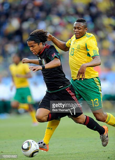 Giovani Dos Santos of Mexico chased by Kagisho Dikgacoi of South Africa during the 2010 FIFA World Cup South Africa Group A match between South...