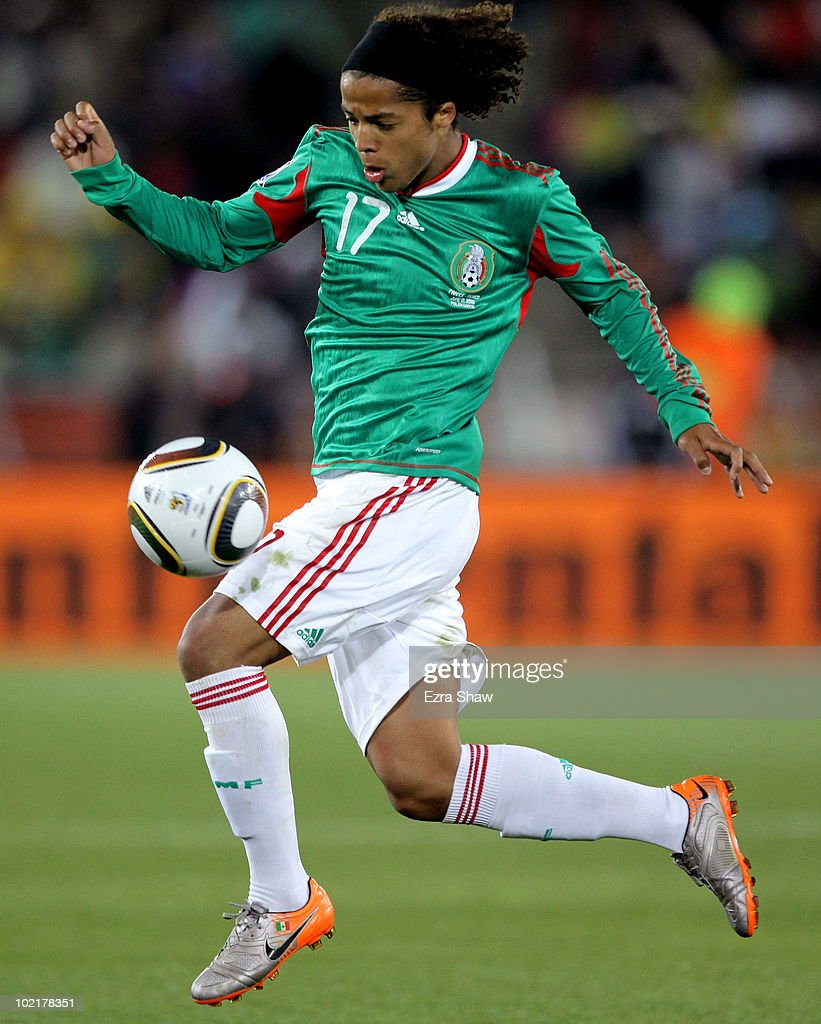 Giovani Dos Santos of Mexico controls the ball during the 2010 FIFA World Cup South Africa Group A match between France and Mexico at the Peter Mokaba Stadium on June 17, 2010 in Polokwane, South Africa.