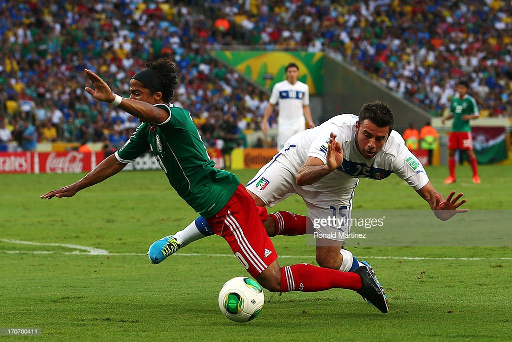 <a gi-track='captionPersonalityLinkClicked' href=/galleries/search?phrase=Giovani+dos+Santos&family=editorial&specificpeople=4435901 ng-click='$event.stopPropagation()'>Giovani dos Santos</a> of Mexico is brought down in the penalty box by <a gi-track='captionPersonalityLinkClicked' href=/galleries/search?phrase=Andrea+Barzagli&family=editorial&specificpeople=465353 ng-click='$event.stopPropagation()'>Andrea Barzagli</a> of Italy during the FIFA Confederations Cup Brazil 2013 Group A match between Mexico and Italy at the Maracana Stadium on June 16, 2013 in Rio de Janeiro, Brazil.