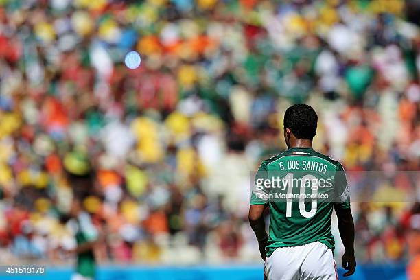 Giovani Dos Santos of Mexico looks on during the 2014 FIFA World Cup Brazil Round of 16 match between Netherlands and Mexico at Castelao on June 29...