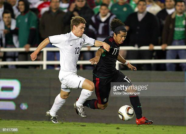 Giovani Dos Santos of Mexico paces the ball on the left wing against Michael McGlinchey of New Zealand in the second half during their International...