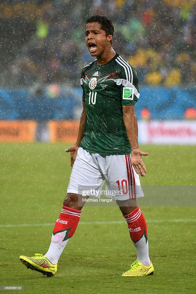 Giovani dos Santos of Mexico reacts after his goal was disallowed due to an offsides call in the first half during the 2014 FIFA World Cup Brazil Group A match between Mexico and Cameroon at Estadio das Dunas on June 13, 2014 in Natal, Brazil.