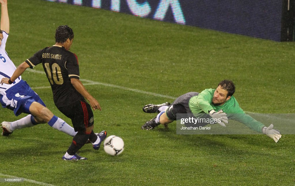 Giovani Dos Santos #10 of Mexico scores a goal past <a gi-track='captionPersonalityLinkClicked' href=/galleries/search?phrase=Asmir+Begovic&family=editorial&specificpeople=4184467 ng-click='$event.stopPropagation()'>Asmir Begovic</a> #1 of Bosnia-Herzegovina during an international friendly at Soldier Field on May 31, 2012 in Chicago, Illinois.