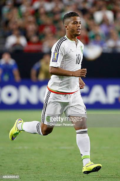 Giovani Dos Santos of Mexico subs in during the 2015 CONCACAF Gold Cup group C match against Guatemala at University of Phoenix Stadium on July 12...
