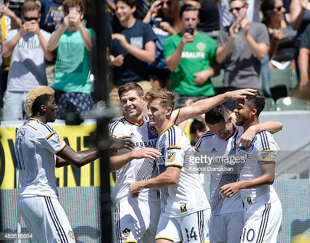 Giovani Dos Santos of the Los Angeles Galaxy is congratulated by teammates from left to right Gyasi Zardes Steven Gerrard Robbie Rogers and Robbie...