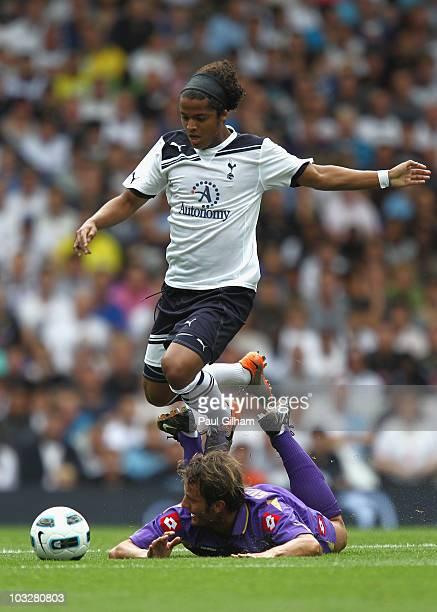 Giovani Dos Santos of Tottenham Hotspur battles for the ball with Alberto Gilardino of Fiorentina during the preseason friendly match between...