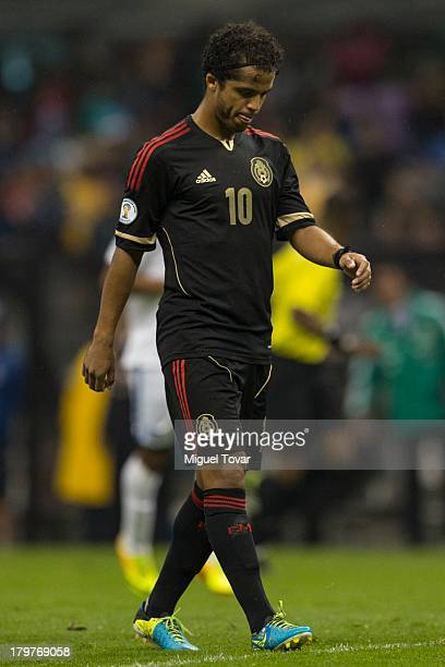 Giovani Dos Santos reacts after losing against Honduras during a match between Mexico and Honduras as part of the 15th round of the South American...