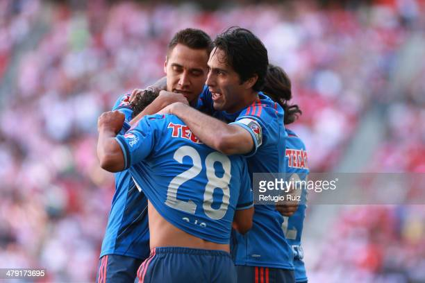 Giovani Hernandez of Chivas celebrates with his teammates after scoring the opening goal during a match between Chivas and Leon as part of the round...