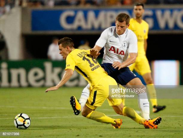Giovani Lo Celso of Paris SaintGermain is tackled for a foul by Jan Vertonghen of Tottenham Hotspur during their international friendly match on July...