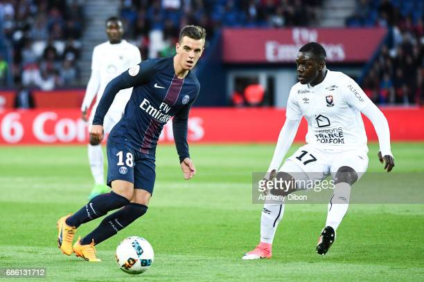 Giovani Lo Celso of PSG and Jean Victor Makengo of Caen during the Ligue 1 match between Paris SaintGermain and SM Caen at Parc des Princes on May 20...