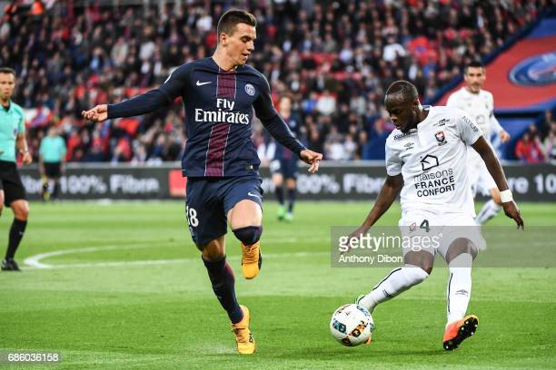 Giovani Lo Celso of PSG and Tiemoko Diomande of Caen during the Ligue 1 match between Paris SaintGermain and SM Caen at Parc des Princes on May 20...