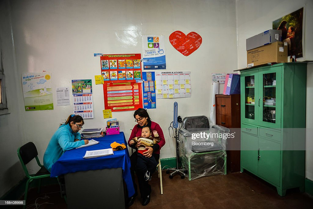 Giovanna Arroya, right, holds her son, Paolo, at the health clinic in the town of La Oroya, Peru, on Thursday, March 21, 2013. Most of La Oroyaís children suffer elevated lead levels, according to the Peruvian government. The question of responsibility for lead pollution in La Oroya is at the center of high-stakes clash between Peru and U.S. billionaire Ira Rennert, who owned Doe Run Peru for more than a decade through Renco Group Inc., a metals, mining and industrial conglomerate based in New York that has said it is not responsible for the childrenís ills. Photographer: Meridith Kohut/Bloomberg via Getty Images