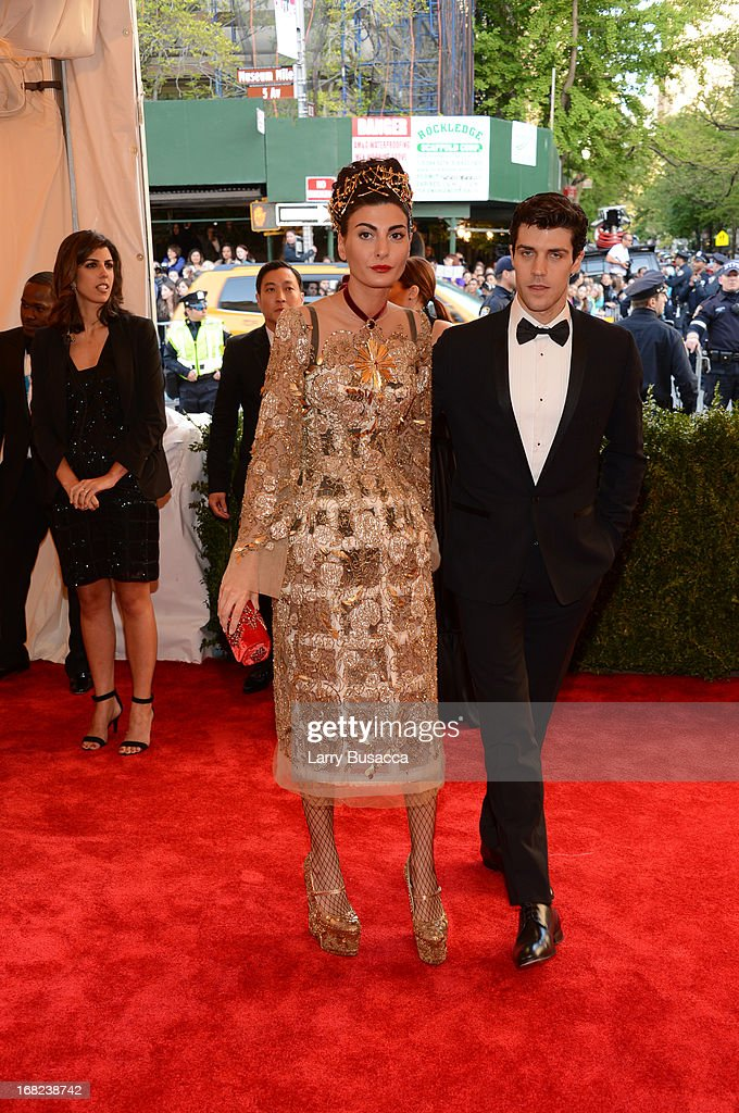 Giovanna Battaglia and Roberto Bolle attend the Costume Institute Gala for the 'PUNK: Chaos to Couture' exhibition at the Metropolitan Museum of Art on May 6, 2013 in New York City.