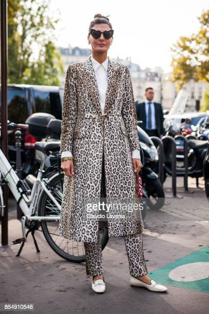 Giovanna Battaglia Engelbert wearing a coat and pants with leo print is seen after the Dries van Noten fashion show during Paris Fashion week...