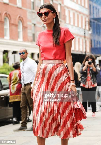 Giovanna Battaglia is seen wearing a red and silver skirt outside the Jason Wu show during New York Fashion Week Women's S/S 2018 on September 8 2017...