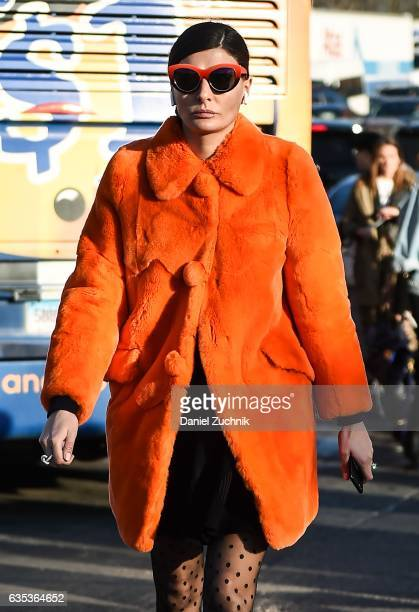 Giovanna Battaglia is seen wearing an orange coat outside the Coach show during New York Fashion Week Women's Fall/Winter 2017 on February 14 2017 in...