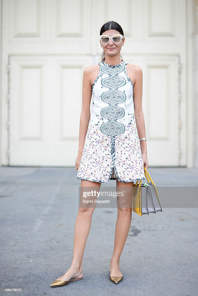 Giovanna Battaglia poses wearing a Giambattista Valli dress and Miu Miu bag on the streets of Paris during Paris Fashion Week on October 1 2014 in...