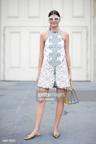 Giovanna Battaglia poses wearing a Giambattista Valli dress and Miu Miu bag on the streets of Paris during Paris Fashion Week on October 1 2014 in...
