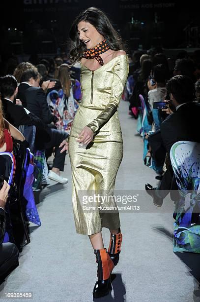 Giovanna Battaglia walks during the fashion show runway as part of amfAR's 20th Annual Cinema Against AIDS during The 66th Annual Cannes Film...