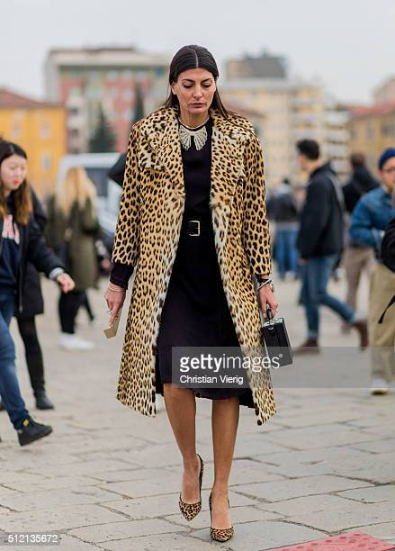 Giovanna Battaglia wearing a leopard printed wool coat and heels and a black dress seen outside Gucci during Milan Fashion Week Fall/Winter 2016/17...