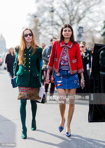 Giovanna Battaglia wearing a red Chanel blazer and denim skirt and Micol Sabbadini wearing a green Chanel jacket outside Chanel during the Paris...