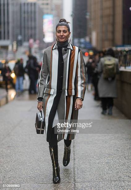 Giovanna Battaglia wearing a striped rain coat seen outside Vera Wang during New York Fashion Week Women's Fall/Winter 2016 on February 16 2016 in...